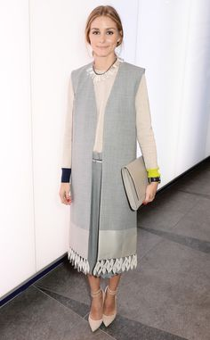 Olivia Palermo from Stars at London Fashion Week Spring 2015  The famous fashionista covers up with a long gray design at the Whistles show.