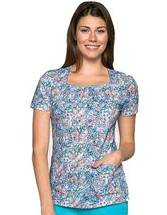 Stylish uniform scrubs in classic Junior fit with Flying Free print in square neckline accentuated with contrast merrow edge and smocking around the neckline