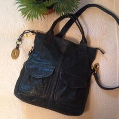 "Fossil Handbag Gorgeous dark green weathered leather handbag, can be worn as a tote or cross body. Measures 13.5"" x12.5"" strap extends to 49"" This is in excellent used condition! Weathered leather is the style, not from use. Fossil Bags Crossbody Bags"