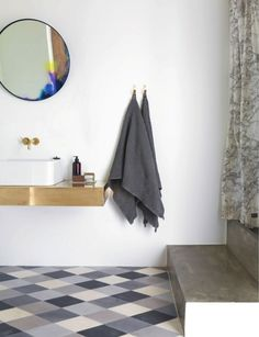 Love the multi grey toned floor tiles and the polished cement steps, Milk Magazine