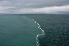 This is the place where two oceans meet... but do not mix! INCREDIBLE AND SIMPLY MIND-BLOWING!!!    These two bodies of water were merging in the middle of The Gulf of Alaska and there was a foam developing only at their junction. It is a result of the melting glaciers being composed of fresh water and the ocean has a higher percentage of salt causing the two bodies of water to have different densities and therefore makes it more difficult to mix.