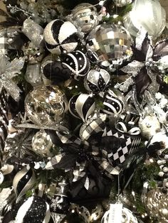 Not a RAZ tree, but still ….black, white and silver…….some of these products are from Craig Bachman and we have the black/white diamond pattern ornaments coming. Hard to tell if there is a tree in there!