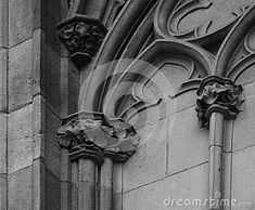 Shot in black and white detail on the sculpture on the facade of this historic building cathedral representing some flowers. Set in Eixample, Barcelona, Catalunya, Spain, Europe