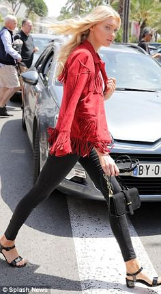 Working it: Elsa later changed into a red suede tassel-detail jacket, which she teamed wit...