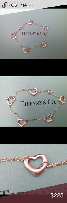 "Tiffany & Co. Open Heart Bracelet Like new, authentic sterling silver Tiffany Elsa Peretti open heart bracelet.  Comes with pouch  and box. 7"" Tiffany & Co. Jewelry Bracelets"