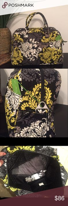 Vera Bradley Weekender Bag Baroque Retired New, Never Used Retired Pattern with solid black interior.  Pockets galore!  Outside has two sleeve pockets on front, two slimmer sleeve pockets on back with trolley sleeve so bag can slip on luggage handle securely ! Open the double zipper pulls and find 2 large pockets on one wall and three on other. Pic shows detachable , adjustable shoulder strap with shiny silvertone hardware.  Sturdy removable bottom for laundering. Vera Bradley Bags Travel…