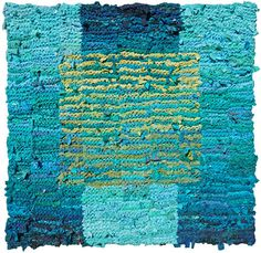 Shades of teal fade from light to dark and back again in the background, while a square of olive and lime shades dances in the foreground of this rug, reminiscent of the sea. This is one in a series o