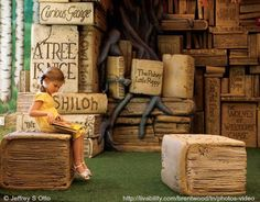 Five-year-old Lilly Otto reads a book at the Brentwood Library's children area following the annual Easter egg hunt.  Brentwood, Tennessee. Little Girl, Oversize Trompe L'oeil Books. Photo (detail) © Jeffrey S Otto (Photographer)  ...