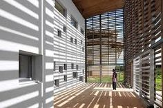 RH+Architecture designed a library in French Guiana as a building completely encased in timber lattice. Timber Architecture, Architecture Design, Public Architecture, Tropical Architecture, Facade Design, House Design, In Praise Of Shadows, Shading Device, Air Ventilation