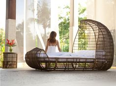 Kenneth Cobonpue, a young designer from the Philippines creates gorgeous furniture that combines the beauty and simplicity of modern design with the use of natural fibers and locally sourced organic materials.    The bed above, from the Voyage series, is made from either Buri (palm leaf spines) or abaca (also known as Manila hemp) which is hand woven on a steel frame and tied with abaca rope. The effect is like an airy cocoon, at once enveloping and giving the sense of space and freedom.