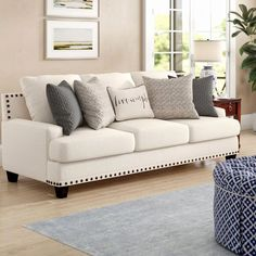 Perfect for lounging and relaxing in style, this farmhouse-chic sofa features recessed square track arms, and tapered block feet in a weathered pecan stain. Enveloped in polyester upholstery, this sofa features detailed stitching and patina nailhead trim. Living Room Sets, Living Room Designs, Living Room Furniture, Home Furniture, Living Room Decor, Rustic Furniture, Modern Furniture, Coaster Furniture, Leather Furniture