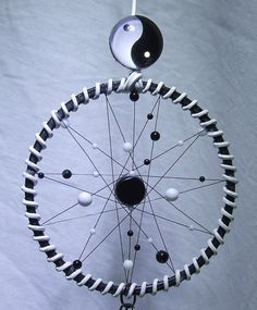 Check out this item in my Etsy shop https://www.etsy.com/uk/listing/269844680/yin-yang-dream-catcher-wall-hanging-zen
