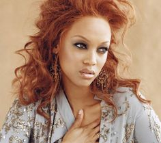 Tyra Banks Auburn hair.  Could I pull this off?