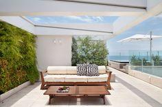 Outdoor lounging and living. (Cobertura Triplex by Izabela Lessa Arquitetura, Rio de Janeiro, Brazil)