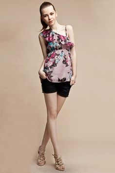 This blouse crafted in polyester fiber, featuring floral printing to the main, one shoulder detail with flouncing panel design, high elastic waist, in medium length cut.$84
