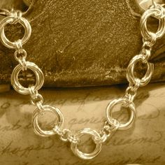 Floret Chain Jump Ring Chain. Free Step-by-Step Instructions. Visit the website for step-by-step instructions, kits and supplies and other chainmail projects
