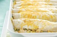 Savor the tastes of the sea with these creamy Seafood Enchiladas for dinner tonight! #recipe #Mexican
