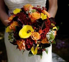 A mix of luscious colors create an awesome autumnal bouquet. Via Make Gorgeous Flower Choices for Your Wedding at FloristChronicles.com.