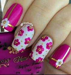 white pink and gold flower nail polish design with gold studs perfect for spring love these flowers!