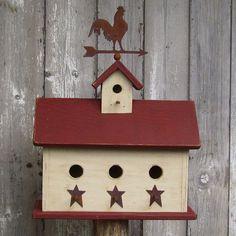 Primitive birdhouse with weather vane