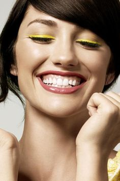 A bright yellow liner can add a burst of color to your makeup