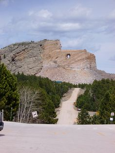 The Crazy Horse Memorial is a mountain monument under construction in the Black Hills of South Dakota, in the form of Crazy Horse, an Oglala Lakota warrior, riding a horse and pointing into the distance.    The memorial consists of the mountain carving (monument), the Indian Museum of North America, and the Native American Cultural Center. The monument is being carved out of Thunderhead Mountain on land considered sacred by some Native Americans, between Custer and Hill City, roughly 8 miles awa