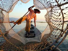 An Intha leg rower demonstrates his skill on Inle Lake, Myanmar (Burma). Inle Lake, Outdoor Furniture, Outdoor Decor, Hammock, Louvre, Building, Travel, Viajes, Buildings