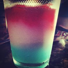 4th of July drink! Strawberry daiquiri, piña colada and hypnotic layered