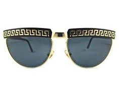 versace sunglasses that look like ray bans  this particular pair of sunglasses are a classic style but with a serious versace twist added to them. the mixture of black and gold make these frames very