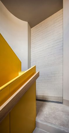 Anna and Eugeni Bach create Barcelona apartment building with bright yellow balconies
