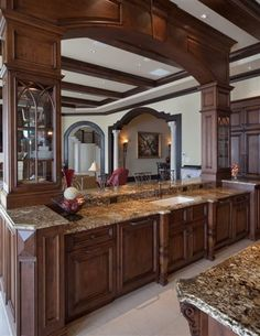I've decided the kitchen needs to have lots of detail in the cabinets and a contrasting wood. Love this granite but the arch wouldn't fit in with the ceiling trusses. Still, love the varying depths and glass doors along with the overall feel.