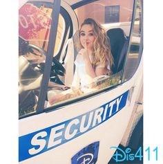 Photo: Sabrina Carpenter Sitting In A Disney Security Vehicle August 19, 2014
