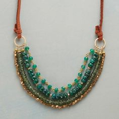 """""""Green Mansions"""" Necklace -  REAL GEMS - four strands of emeralds, green onyx, apatite & faceted brass beads, 14kt gold filled rings - on knotted leather cord - 30"""" on cord (looks like a bracelet hanging from a long cord - Handmade in USA - Sundance  $148"""