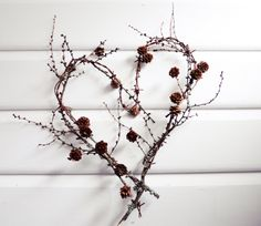 Larch branches in heart shape via Mitt vita hus
