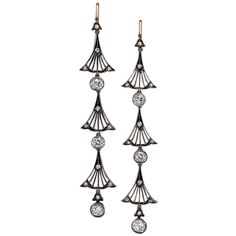 """Art Nouveau or the """"New Art"""" of 1895-1915 took its inspiration from natural forms and structures emphasizing the beauty of the organic curve. These 2 7/8"""" long drop earrings each feature three curvaceous fan designs, typical of the period, which are interspersed with bezel set old European cut diamonds weighting approximately 3.50 carats. Mounted in 14K gold and silver"""