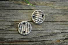 These spacers were sprig molded from shell pieces found on the beach, colored with ceramic stains between multiple firings and finished with a satin fired glaze. Price is for one 2 cm spacer.