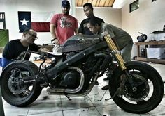 Men at work at Verve Indonesia. Honda Deuville 650 project