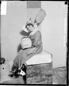 Anna Blanch Morrow dressed as a witch holding a pumpkin with a scary face, Chicago, November 3, 1916. Photograph by Chicago Daily News, Inc. DN-0067239 #broom #chicago #costume #costume #halloween #history #photograph #photography #pumpkin #witch