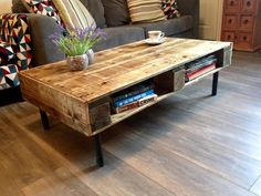 This is a beautiful hand made coffee table. Made from reclaimed pallets sanded and varnished this coffee table has two shelves built in for storage