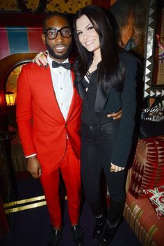 With Jessie J at the Tom Ford Collections Tinie Tempah: old-school and nowadays trendy mixed style! Party at Loulou's in London, Red suit and a blue spotted bow-tie