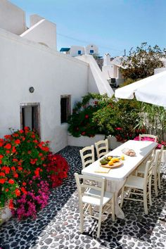 Mansion Sophia is a beautiful villa for rent in Santorini, Greece. Beautiful Villas, Beautiful Places, Casa Patio, Greek House, Terrace Design, Mediterranean Decor, Mediterranean Architecture, Patio Umbrellas, Outdoor Living