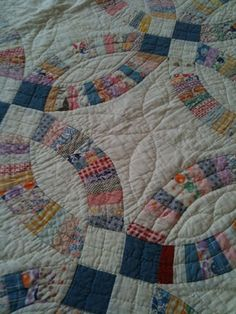 1920s Double Wedding Ring quilt. My great grandmother and granny made quilts. Love my quilts.