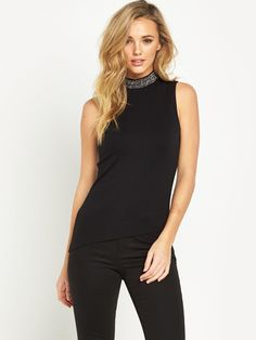 V by VeryEmbellished High Neck Halter Top - Black Switch out your little black dress for something equally as chic, with this embellished high neck halter top from V by Very. Its figure-hugging fabric cascades over your curves to keep your figure in focus, while the modest high neckline and embellished trim ooze glamour and sophistication. Styling Ideas Make an impact as you make your way into twilight hour with wet-look jeans or tailored trousers and dramatic makeup.Washing…