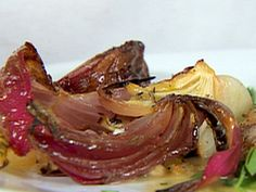 Herb-Roasted Onions - barefoot contessa.  I omitted the thyme and reduced the oil to 4 tsp.  So good!
