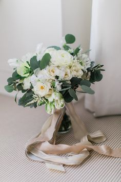bouquet with champagne ribbons - photo by Artistrie Co http://ruffledblog.com/chicago-warehouse-wedding