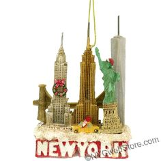 "NYCwebStore.com - New York City Skyline Landmarks Christmas Ornament (http://www.nycwebstore.com/new-york-city-skyline-landmarks-christmas-ornament/) New York City Landmark Skyline Christmas Ornament A great Christmas ornament of NYC for your Christmas tree or shelf this season. These NY ornaments feature the Statue of Liberty, Empire State Building, Chrysler Building, Freedom Tower, NY Taxi and the Brooklyn Bridge. NYC is decked out with a wreath, Santa hat and presents on the taxi.    3.5""H"