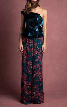 This **Johanna Ortiz** top features a velvet construction and a modified off-the-shoulder neckline.