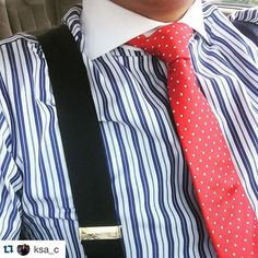 Blue and white striped shirt, black braces and red tie