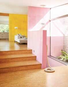 Bright living space with yellow and pink accent walls