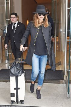 Military chic: Jessica Alba wore a look of success as she checked out of her NY hotel on T...